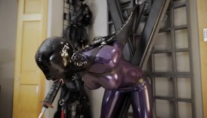 Vespa – Deepthroat in Purple & Pink Latex