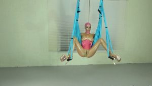 Dildo Fucking Lara in Rubber on the Yoga Swing