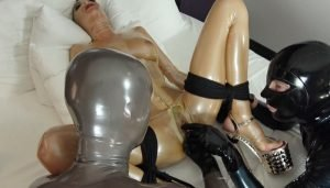 The 2 Rubberguys are Using Metallic Clear Latex Catsuit Lara Bound