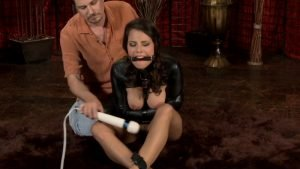 Julia in a leather straitjacket with the blindfold on