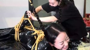 Hinako hard tied in a latex catsuit