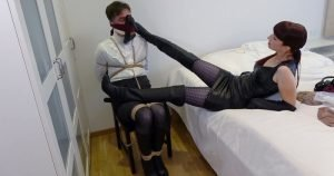 Tied to a chair and gagged in high-heeled boots and worn pantyhose
