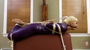 Lola tied up in latex catsuit and helplessly drooling
