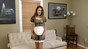 Emily cuffed to the couch in the latex outfit maid